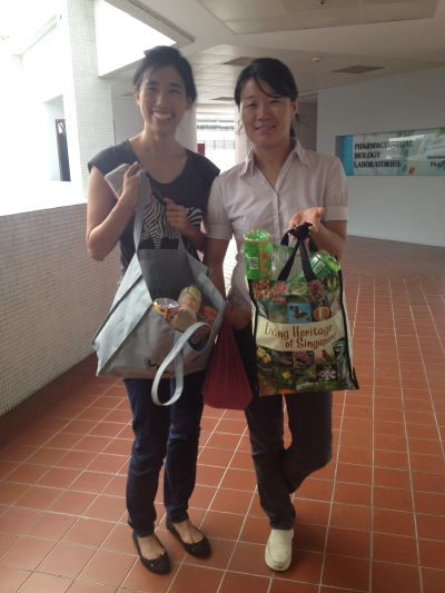 FTTAs Amanda and Hongxia bringing washed and dried plastic bottles to the recycling bins.